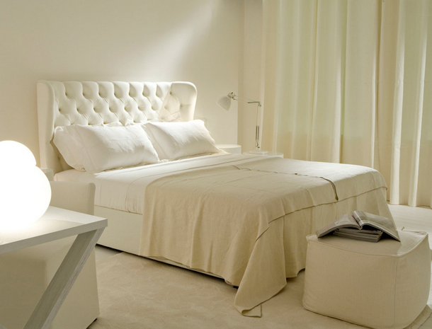 cream white bedroom, tufted upholstered headboard