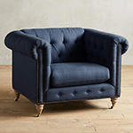 dark blue tufted chair