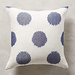 white pillow with purplish-blue dots
