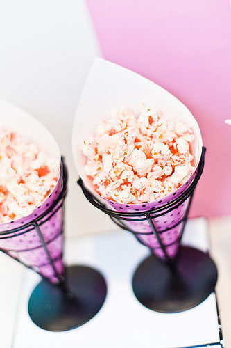 popcorn in lilac pink cone containers