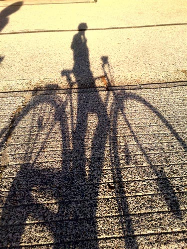 sunset bike shadow