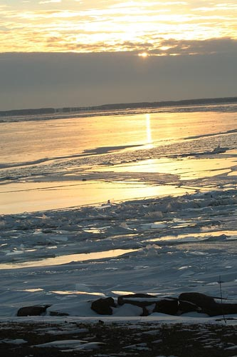 sunset over icy water