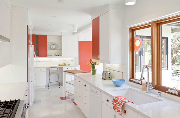 modern white kitchen with coral accents