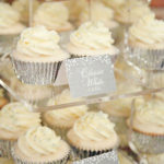cream cupcakes with silver wrapper