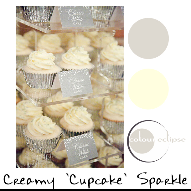 cream cupcakes with silver wrappers