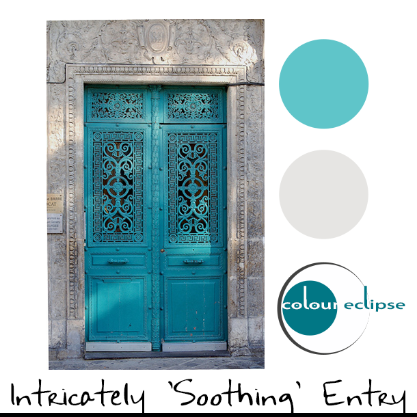 turquoise door on pale gray wall