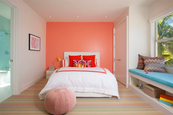 girls bedroom with cadmium orange accent wall