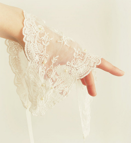 lace fabric draped over ladies hand