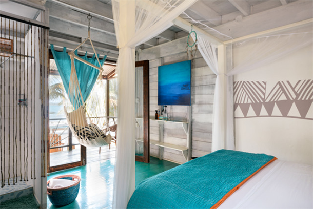 caribbean style bedroom with turquoise accents