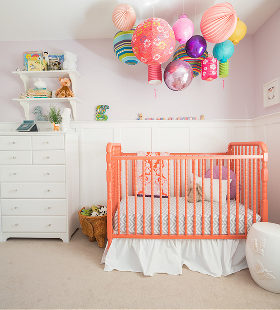 nursery with pantone peach echo coral crib