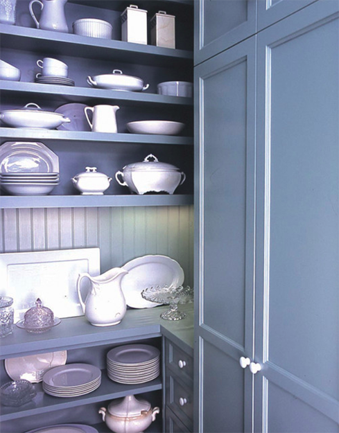 sky blue cupboard with white dishes