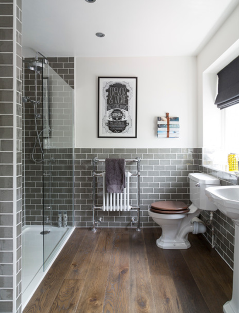 bathroom with gray subway tile walls