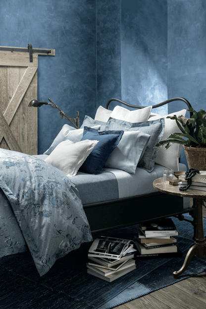 bedroom with washed denim walls