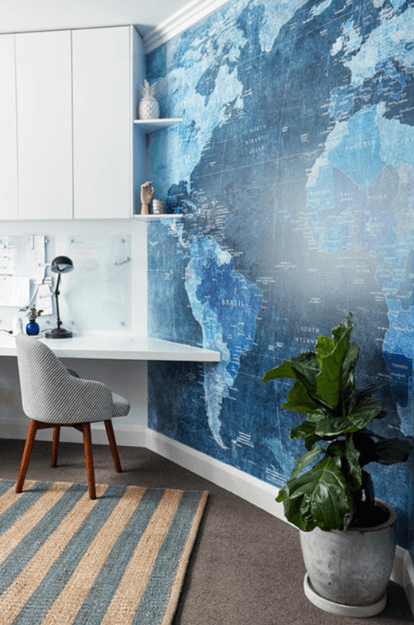 home office with blue map accent wall