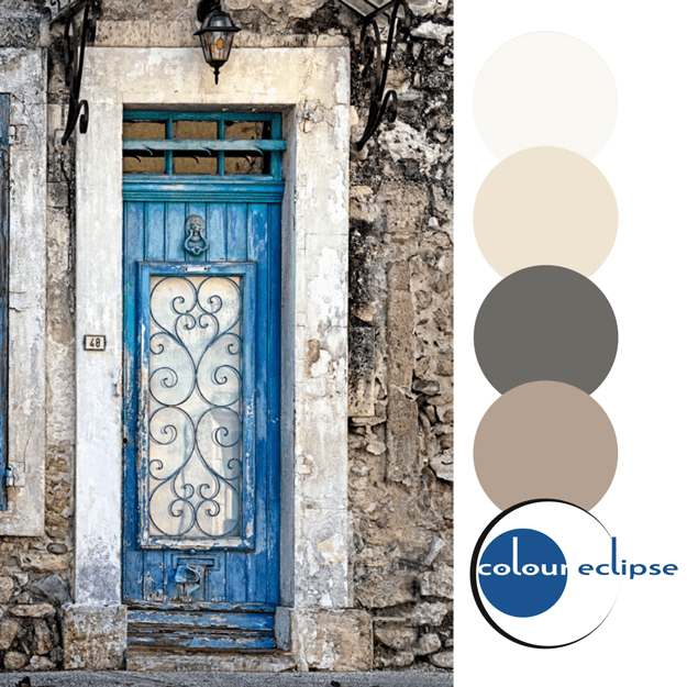 indigo blue door in rustic stone wall with color palette