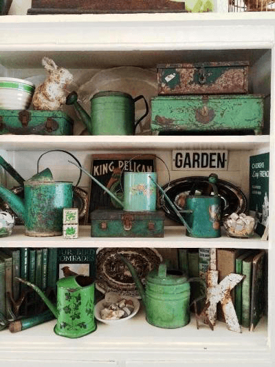 jade green garden collectibles on shelf