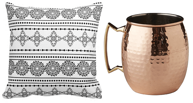 black and white tribal pillow and copper mug