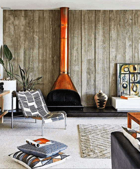 modern rustic living room with copper orange freestanding fireplace