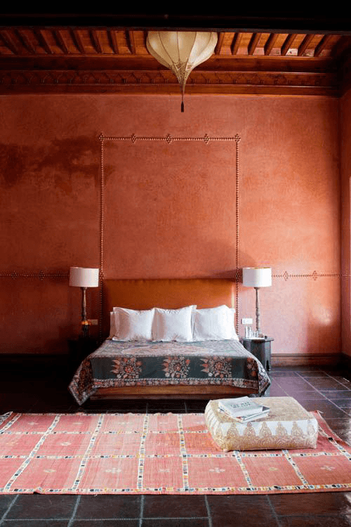 burnt orange hotel interior pantone potter's clay
