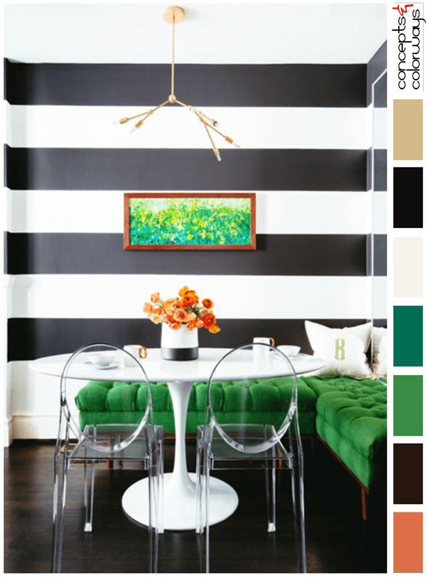 black and white dining room with emerald green accents