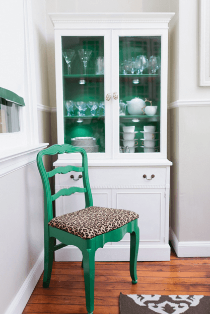 white dining room with emerald green accents