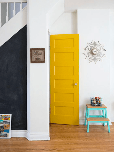 white interior with mustard yellow door