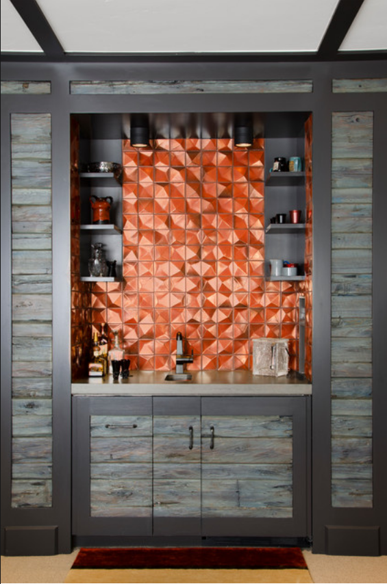 rustic wood built-in bar with copper orange backsplash