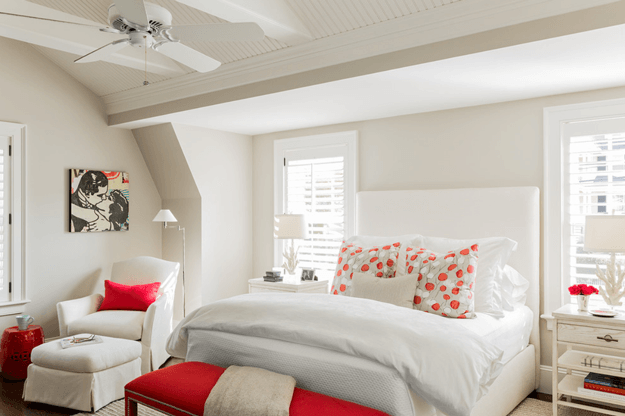 White bedroom with bright red accents pantone aurora red min
