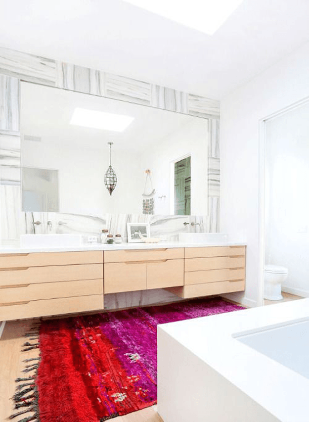 white modern bathroom with bright red rug