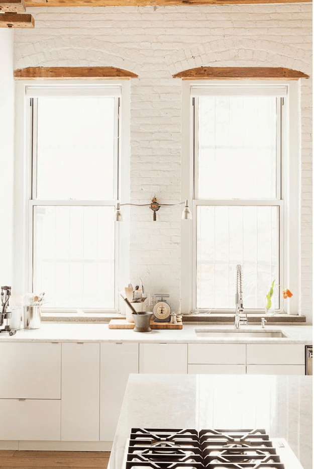 creamy white brick kitchen windows