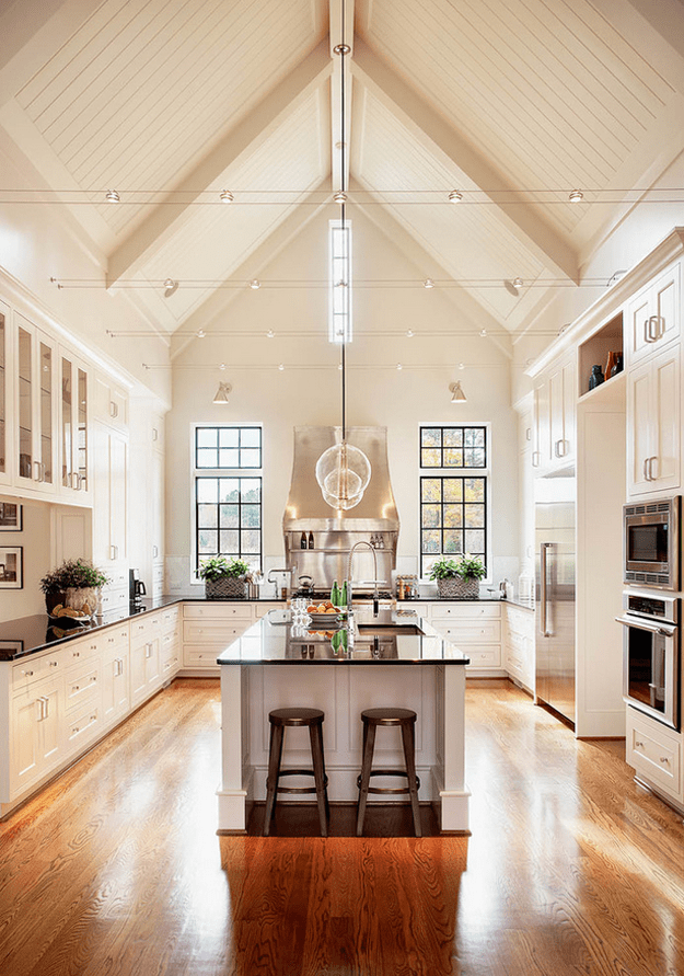 creamy white kitchen with cathedral ceiling