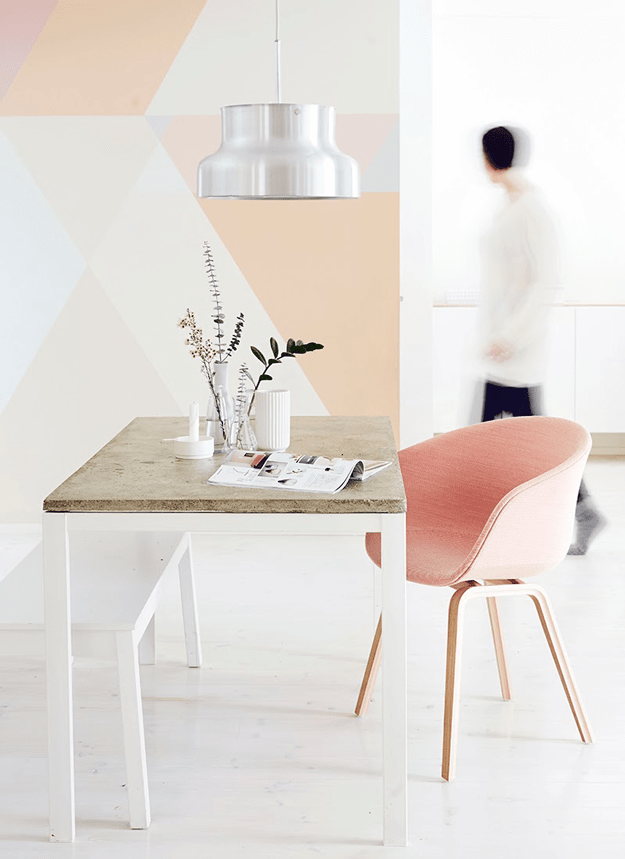 creamy white interior with peach geometric accent wall
