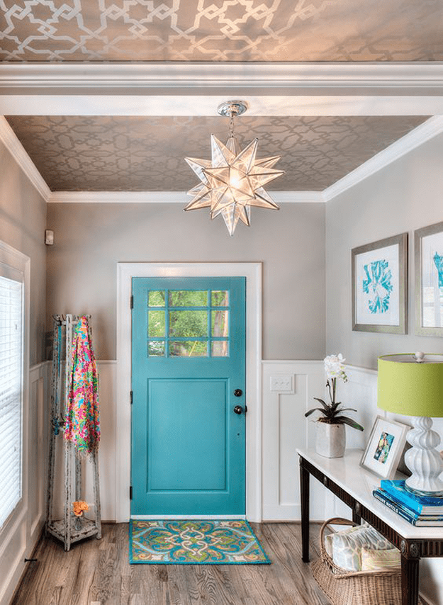 tan and white home entry with turquoise door