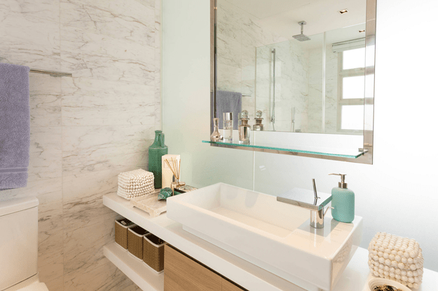modern bathroom with mint green accent wall