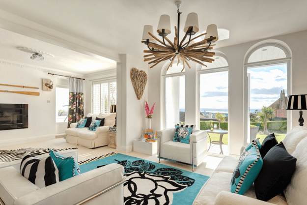 beach style living room with turquoise accents