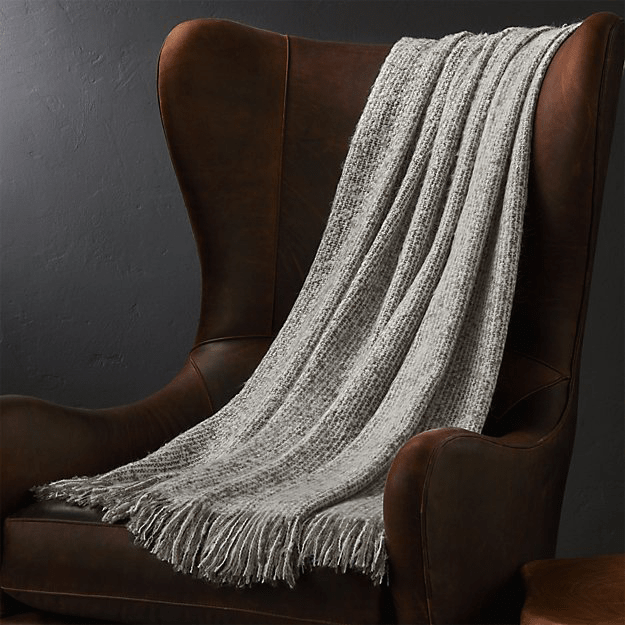 olive gray throw blankete over burgundy chair