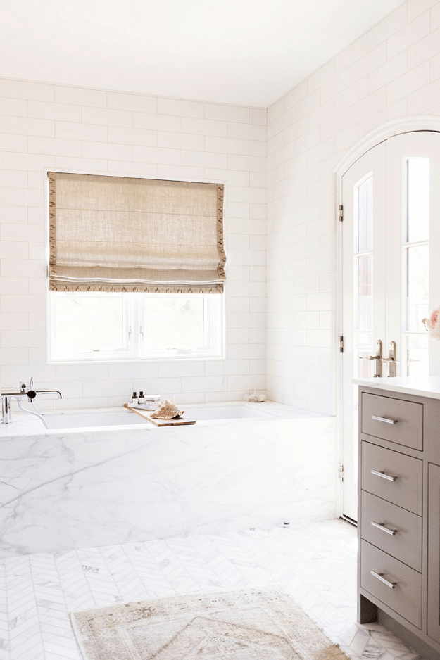 white bathroom with taupe vanity cabinets