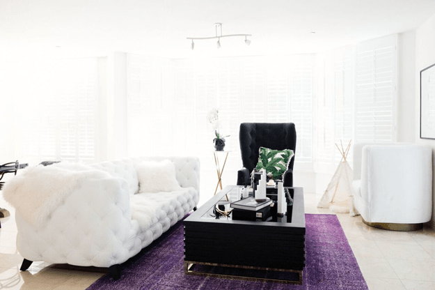 white living room with purple rug