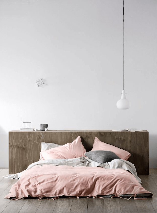 white bedroom with dusty rose bedding