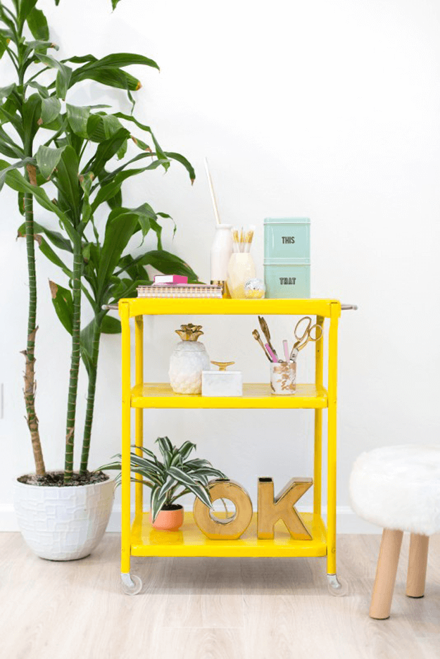 bright yellow cart in white room