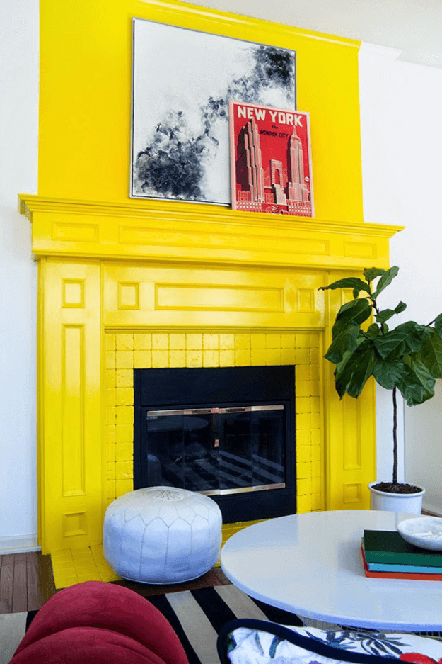 bright yellow painted fireplace