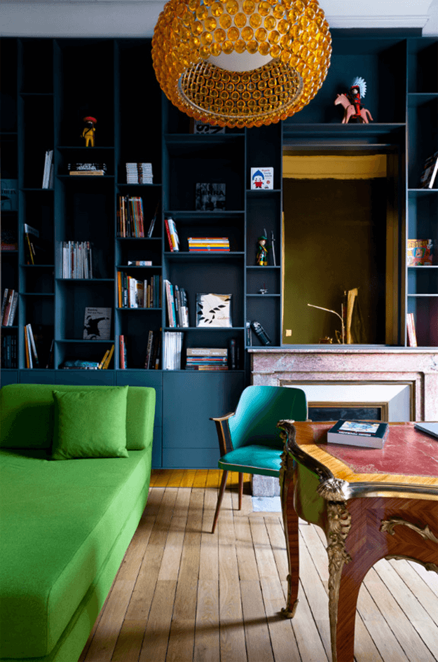 dark apartment interior with bright green settee