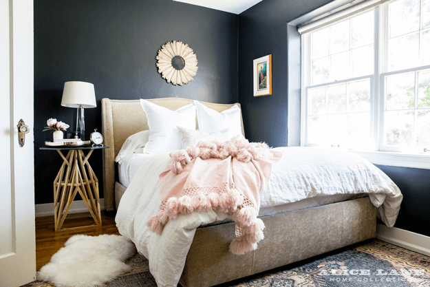 dark navy bedroom with dusty peach accents