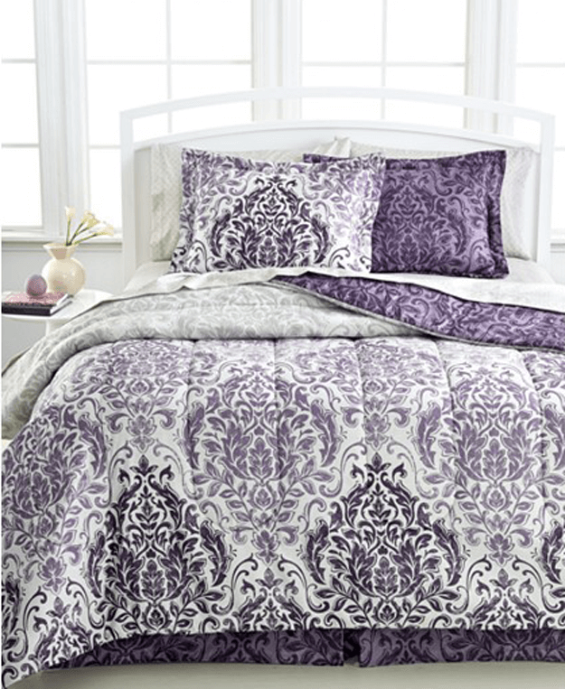 white bedroom with dark purple patterned bedding