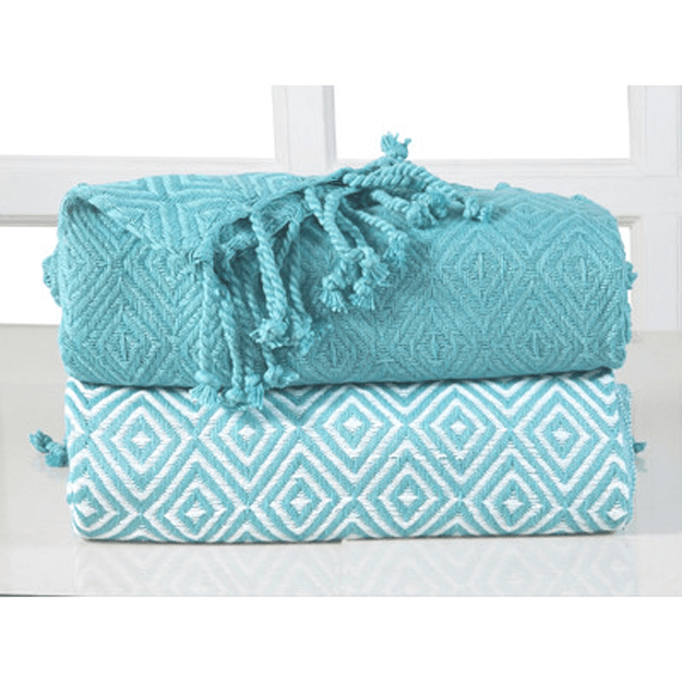 turquoise throws white window sill