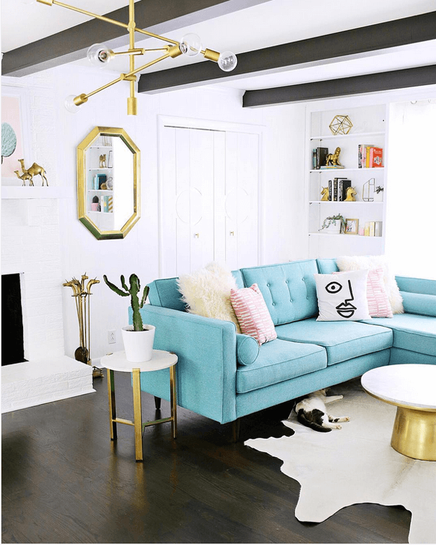 living room with turquoise sectional sofa