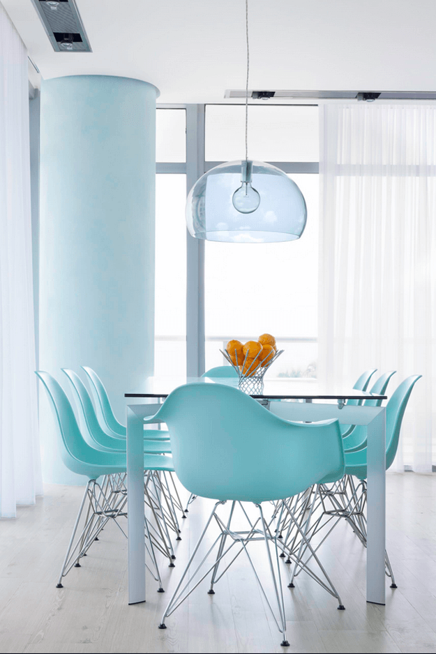modern white dining room with turquoise chairs