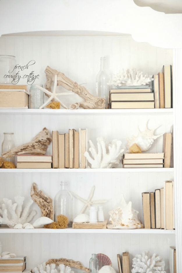 white beach style bookshelves with pantone hazelnut accents