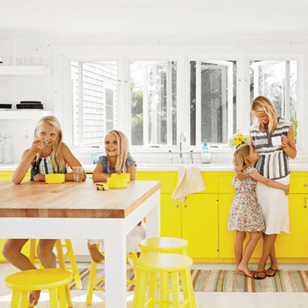 white kitchen with bright yellow base cabinets