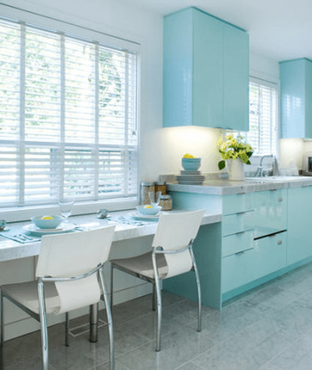 white kitchen with baby blue cabinets